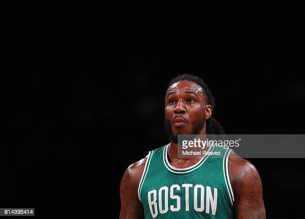 Jae Crowder of the Boston Celtics looks on during the first half of the preseason game against the Brooklyn Nets at Barclays Center on October 13...