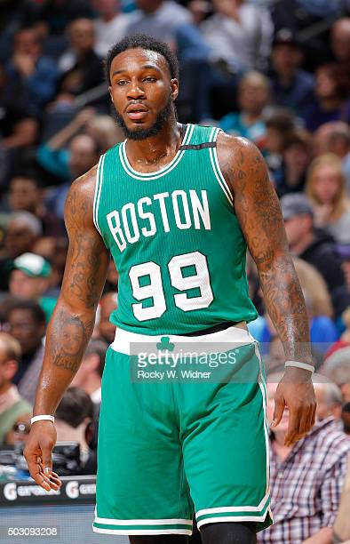 Jae Crowder of the Boston Celtics looks on during the game against the Charlotte Hornets on December 23 2015 at Time Warner Cable Arena in Charlotte...