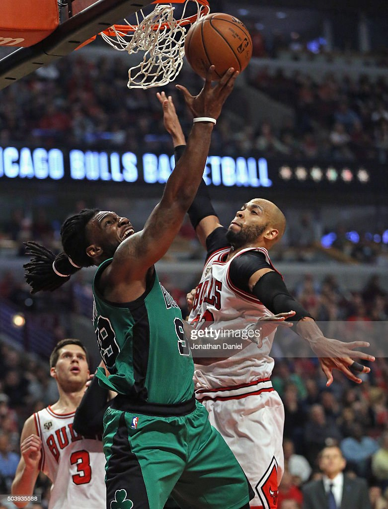 Jae Crowder #99 of the Boston Celtics puts up a shot against Taj Gibson #22 of the Chicago Bulls at the United Center on January 7, 2016 in Chicago, Illinois. The Bulls defeated the Celtics 101-92.