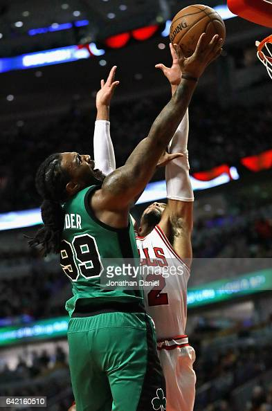Jae Crowder of the Boston Celtics puts up a shot against Taj Gibson of the Chicago Bulls at the United Center on February 16 2017 in Chicago Illinois...