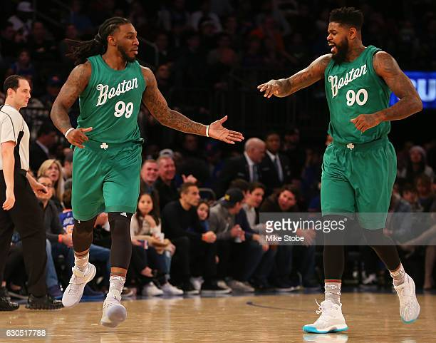 Jae Crowder of the Boston Celtics reacts after hitting a three pointer with teammate Amir Johnson against the New York Knicks at Madison Square...