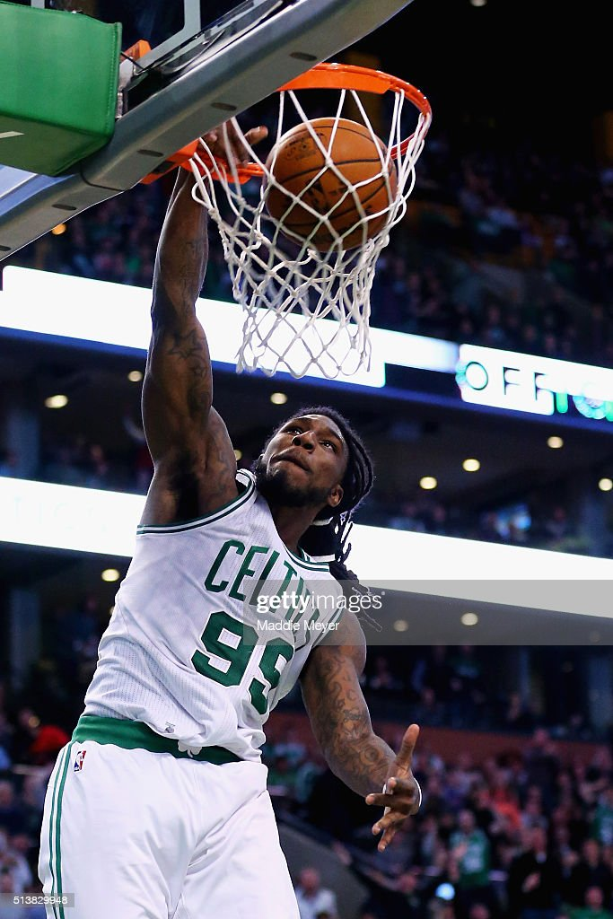 Jae Crowder of the Boston Celtics scores against the New York Knicks during the fourth quarter at TD Garden on March 4 2016 in Boston Massachusetts...