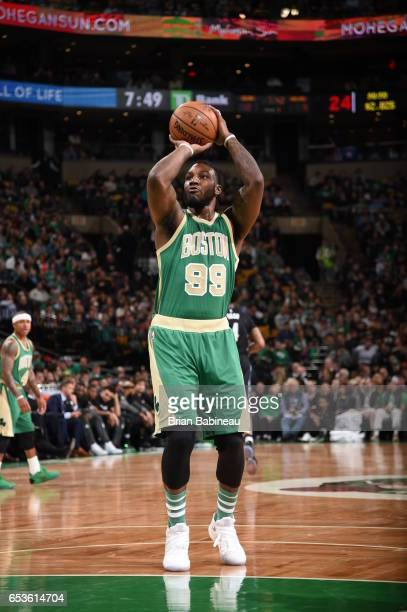 Jae Crowder of the Boston Celtics shoots a free throw against the Minnesota Timberwolves on March 15 2017 at the TD Garden in Boston Massachusetts...