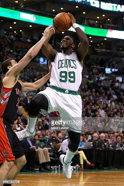 Jae Crowder of the Boston Celtics shoots in the fourth quarter against Greivis Vasquez of the Toronto Raptors at TD Garden on April 14 2015 in Boston...