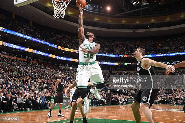 Jae Crowder of the Boston Celtics shoots the ball against the Brooklyn Nets during the game on December 26 2014 at the TD Garden in Boston...