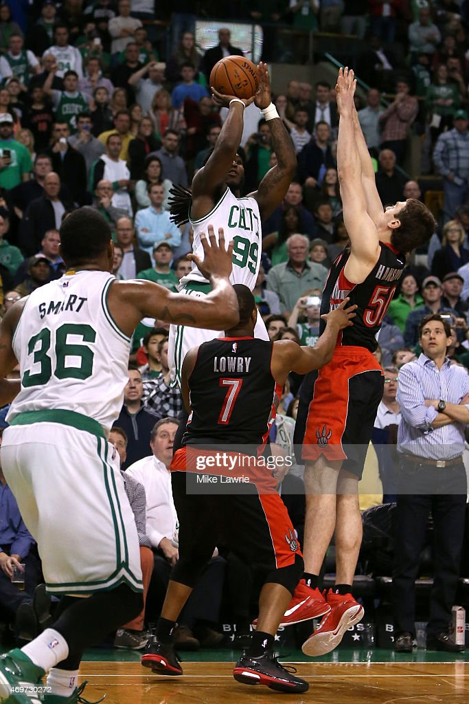 Jae Crowder of the Boston Celtics shoots the game winning basket late in the fourth quarter against Tyler Hansbrough of the Toronto Raptors at TD...