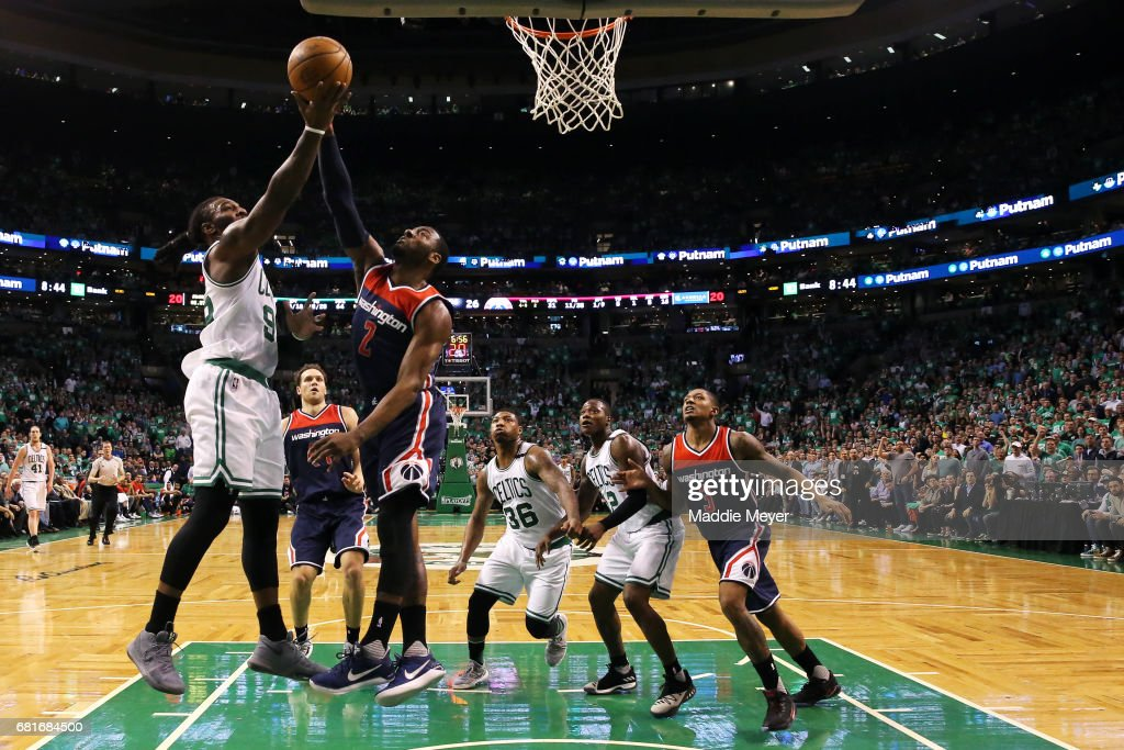 Jae Crowder #99 of the Boston Celtics takes a shot against John Wall #2 of the Washington Wizards during the first half of Game Five of the Eastern Conference Semifinals at TD Garden on May 10, 2017 in Boston, Massachusetts.