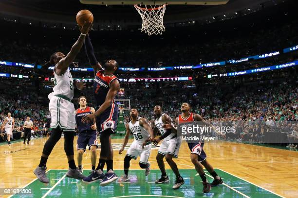 Jae Crowder of the Boston Celtics takes a shot against John Wall of the Washington Wizards during the first half of Game Five of the Eastern...