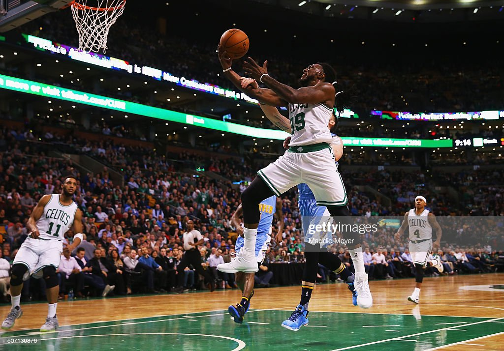 Jae Crowder of the Boston Celtics takes a shot against the Denver Nuggets during the third quarter at TD Garden on January 27 2016 in Boston...