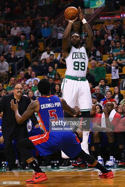 Jae Crowder of the Boston Celtics takes a shot over Kentavious CaldwellPope of the Detroit Pistons during overtime at TD Garden on March 22 2015 in...