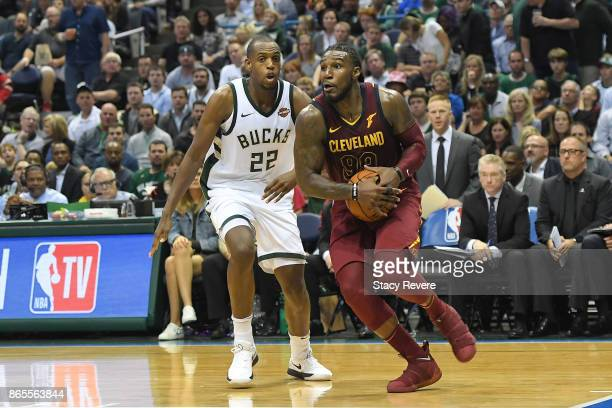 Jae Crowder of the Cleveland Cavaliers drives around Khris Middleton of the Milwaukee Bucks during a game at the Bradley Center on October 20 2017 in...