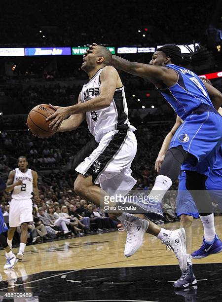 Jae Crowder of the Dallas Mavericks commits a flagrant foul on Tony Parker of the San Antonio Spurs in Game Seven of the Western Conference...