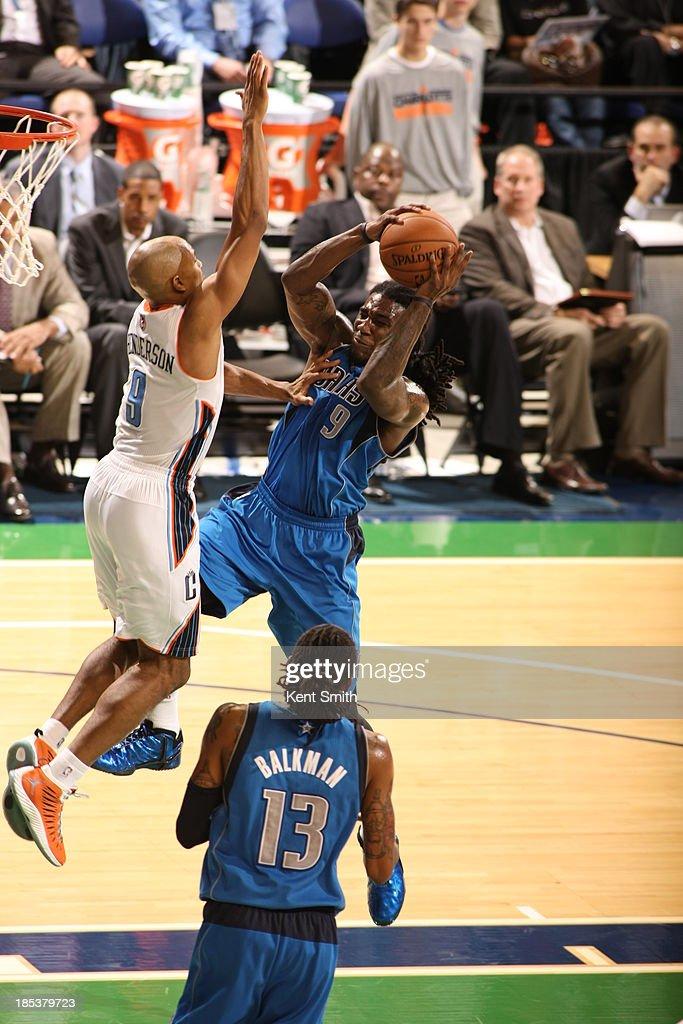 Jae Crowder #9 of the Dallas Mavericks drives against Gerald Henderson #9 of the Charlotte Bobcats at the Greensboro Coliseum on October 19, 2013 in Greensboro, North Carolina.