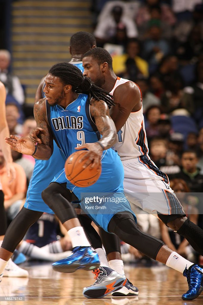<a gi-track='captionPersonalityLinkClicked' href=/galleries/search?phrase=Jae+Crowder&family=editorial&specificpeople=7357507 ng-click='$event.stopPropagation()'>Jae Crowder</a> #9 of the Dallas Mavericks drives against <a gi-track='captionPersonalityLinkClicked' href=/galleries/search?phrase=Michael+Kidd-Gilchrist&family=editorial&specificpeople=8526214 ng-click='$event.stopPropagation()'>Michael Kidd-Gilchrist</a> #14 of the Charlotte Bobcats at the Greensboro Coliseum on October 19, 2013 in Greensboro, North Carolina.