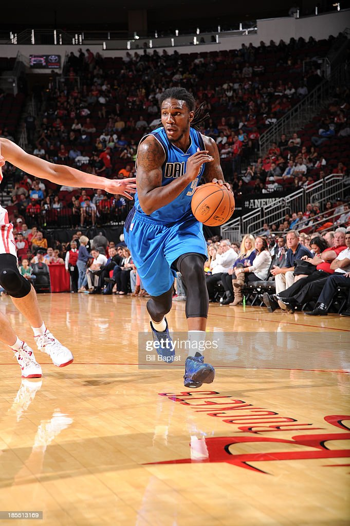 <a gi-track='captionPersonalityLinkClicked' href=/galleries/search?phrase=Jae+Crowder&family=editorial&specificpeople=7357507 ng-click='$event.stopPropagation()'>Jae Crowder</a> #9 of the Dallas Mavericks drives to the basket against the Houston Rockets during a 2013 NBA pre-season game on October 21, 2013 at the Toyota Center in Houston, Texas.