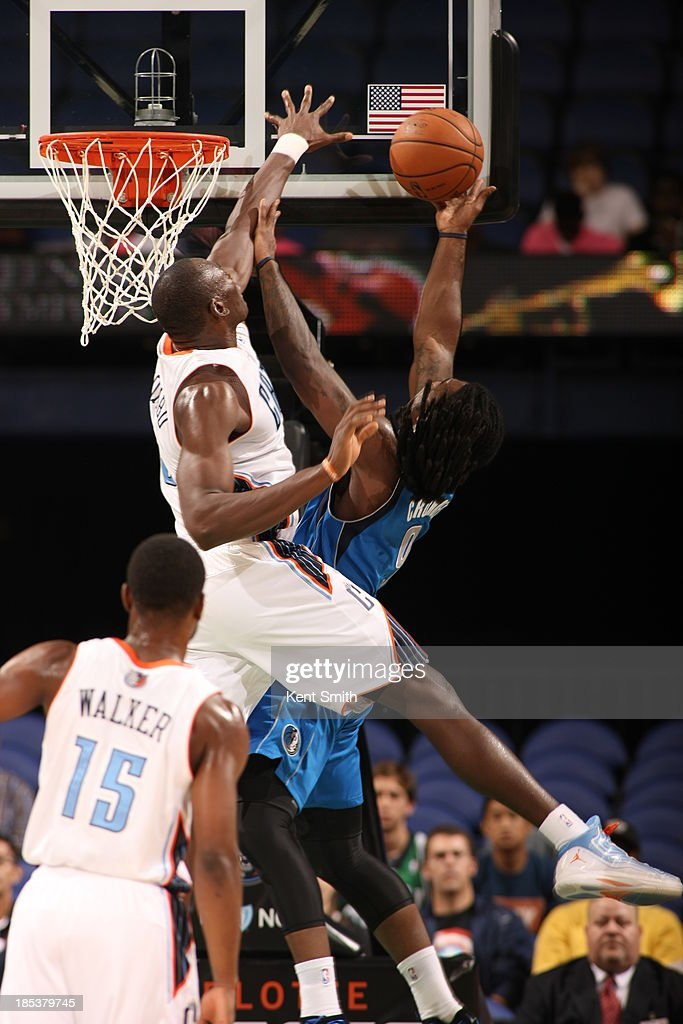 <a gi-track='captionPersonalityLinkClicked' href=/galleries/search?phrase=Jae+Crowder&family=editorial&specificpeople=7357507 ng-click='$event.stopPropagation()'>Jae Crowder</a> #9 of the Dallas Mavericks goes for the dunk against <a gi-track='captionPersonalityLinkClicked' href=/galleries/search?phrase=Bismack+Biyombo&family=editorial&specificpeople=7640443 ng-click='$event.stopPropagation()'>Bismack Biyombo</a> #0 of the Charlotte Bobcats at the Greensboro Coliseum on October 19, 2013 in Greensboro, North Carolina.