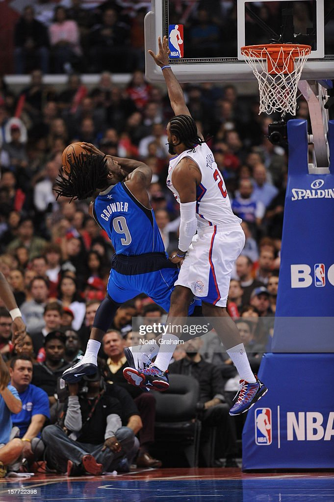 Jae Crowder #9 of the Dallas Mavericks goes to the basket against Ronny Turiaf #21 of the Los Angeles Clippers during the game between the Los Angeles Clippers and the Dallas Mavericks at Staples Center on December 5, 2012 in Los Angeles, California.