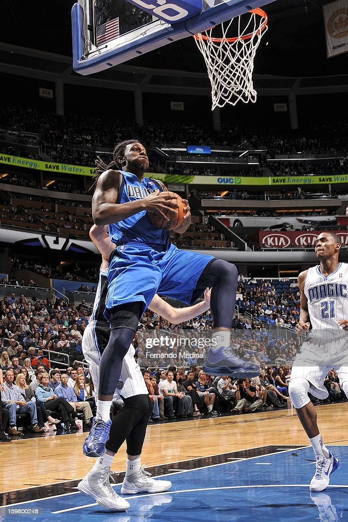 Jae Crowder #9 of the Dallas Mavericks grabs the rebound against the Orlando Magic on January 20, 2013 at Amway Center in Orlando, Florida.
