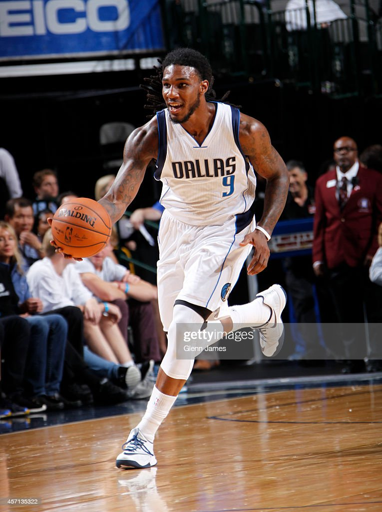 Jae Crowder of the Dallas Mavericks handles the ball against the Indiana Pacers on October 12 2014 at the American Airlines Center in Dallas Texas...