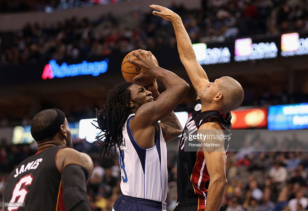 Jae Crowder #9 of the Dallas Mavericks is fouled by Shane Battier #31 of the Miami Heat at American Airlines Center on December 20, 2012 in Dallas, Texas.