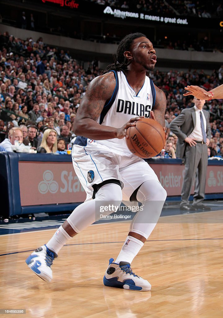 <a gi-track='captionPersonalityLinkClicked' href=/galleries/search?phrase=Jae+Crowder&family=editorial&specificpeople=7357507 ng-click='$event.stopPropagation()'>Jae Crowder</a> #9 of the Dallas Mavericks looks to score against the Los Angeles Clippers on March 26, 2013 at the American Airlines Center in Dallas, Texas.