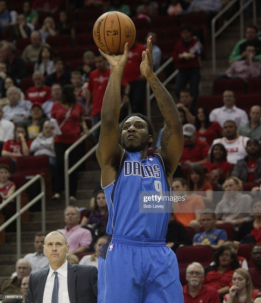 <a gi-track='captionPersonalityLinkClicked' href=/galleries/search?phrase=Jae+Crowder&family=editorial&specificpeople=7357507 ng-click='$event.stopPropagation()'>Jae Crowder</a> #9 of the Dallas Mavericks puts a shot from the corner against the Houston Rockets at Toyota Center on November 1, 2013 in Houston, Texas.