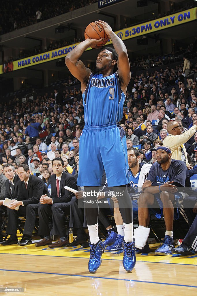 Jae Crowder of the Dallas Mavericks shoots a three pointer against the Golden State Warriors on December 11 2013 at Oracle Arena in Oakland...