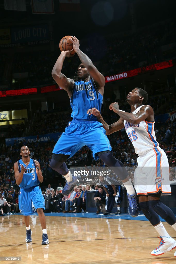 Jae Crowder #9 of the Dallas Mavericks shoots against DeAndre Liggins #25 of the Oklahoma City Thunder on February 4, 2013 at the Chesapeake Energy Arena in Oklahoma City, Oklahoma.