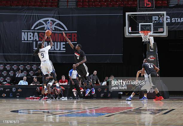 Jae Crowder of the Dallas Mavericks shoots the ball against JaMychal Green of the Los Angeles Clippers during NBA Summer League game between the...