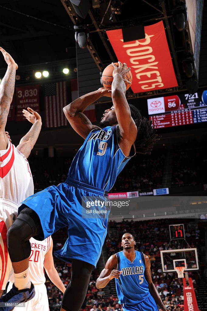 <a gi-track='captionPersonalityLinkClicked' href=/galleries/search?phrase=Jae+Crowder&family=editorial&specificpeople=7357507 ng-click='$event.stopPropagation()'>Jae Crowder</a> #9 of the Dallas Mavericks shoots the ball against the Houston Rockets during a 2013 NBA pre-season game on October 21, 2013 at the Toyota Center in Houston, Texas.