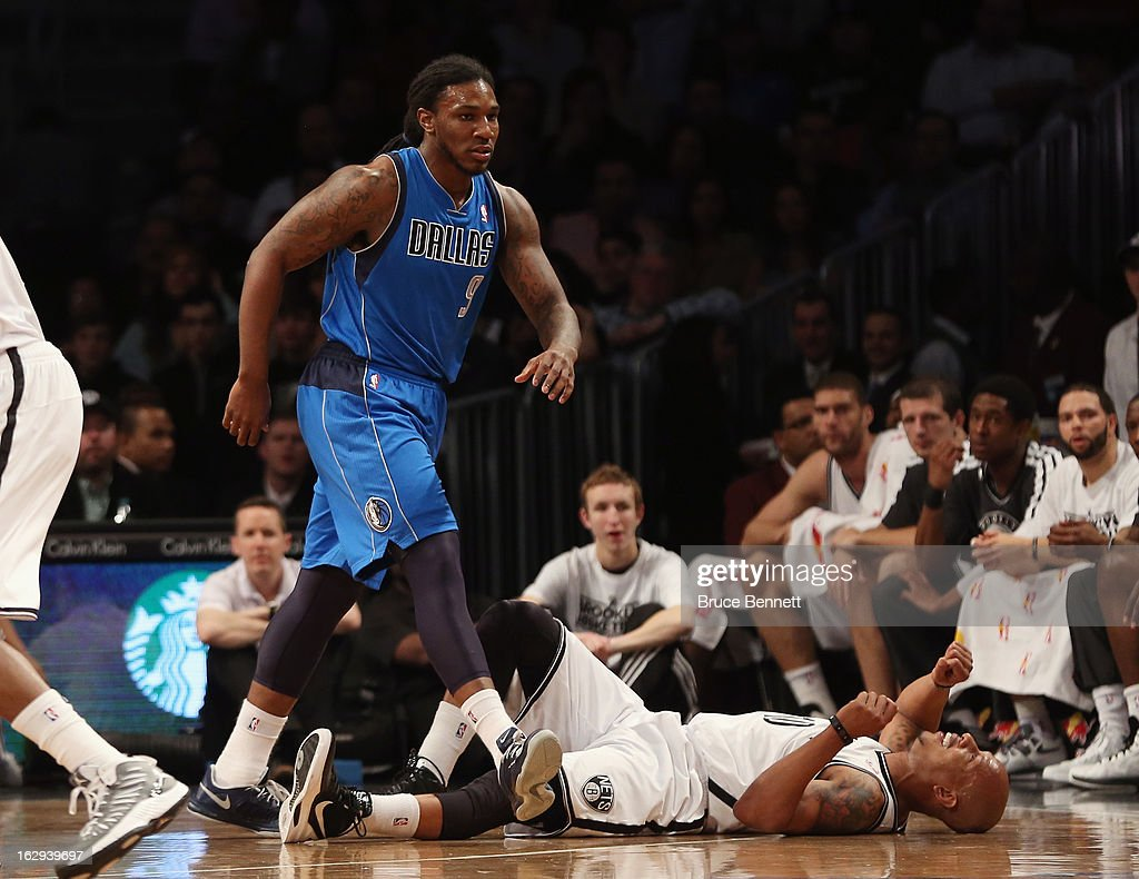 Jae Crowder #9 of the Dallas Mavericks walks away after being fouled by Keith Bogans #10 of the Brooklyn Nets at the Barclays Center on March 1, 2013 in New York City.