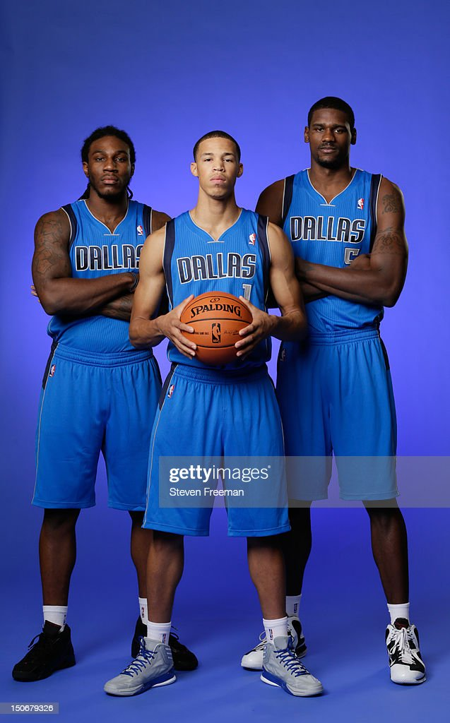 Jae Crowder #9,Bernard James #25 and Jared Cunningham #1 of the Dallas Mavericks poses for a portrait during the 2012 NBA rookie photo shoot on August 21, 2012 at the MSG Training Facility in Tarrytown, New York.