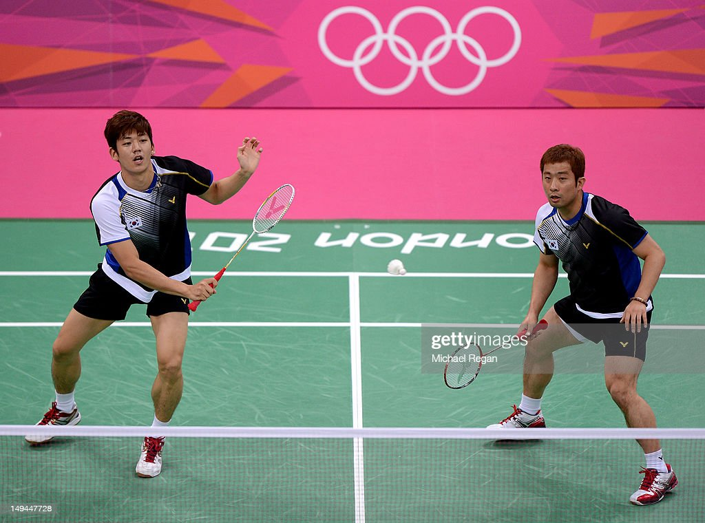 Jae Sung Chung (R) and Yong Dae Lee (L) of Korea returns a shot against Tony Gunawan and Howard Bach of the United States during their Men's Doubles Badminton on Day 1 of the London 2012 Olympic Games at Wembley Arena on July 28, 2012 in London, England.