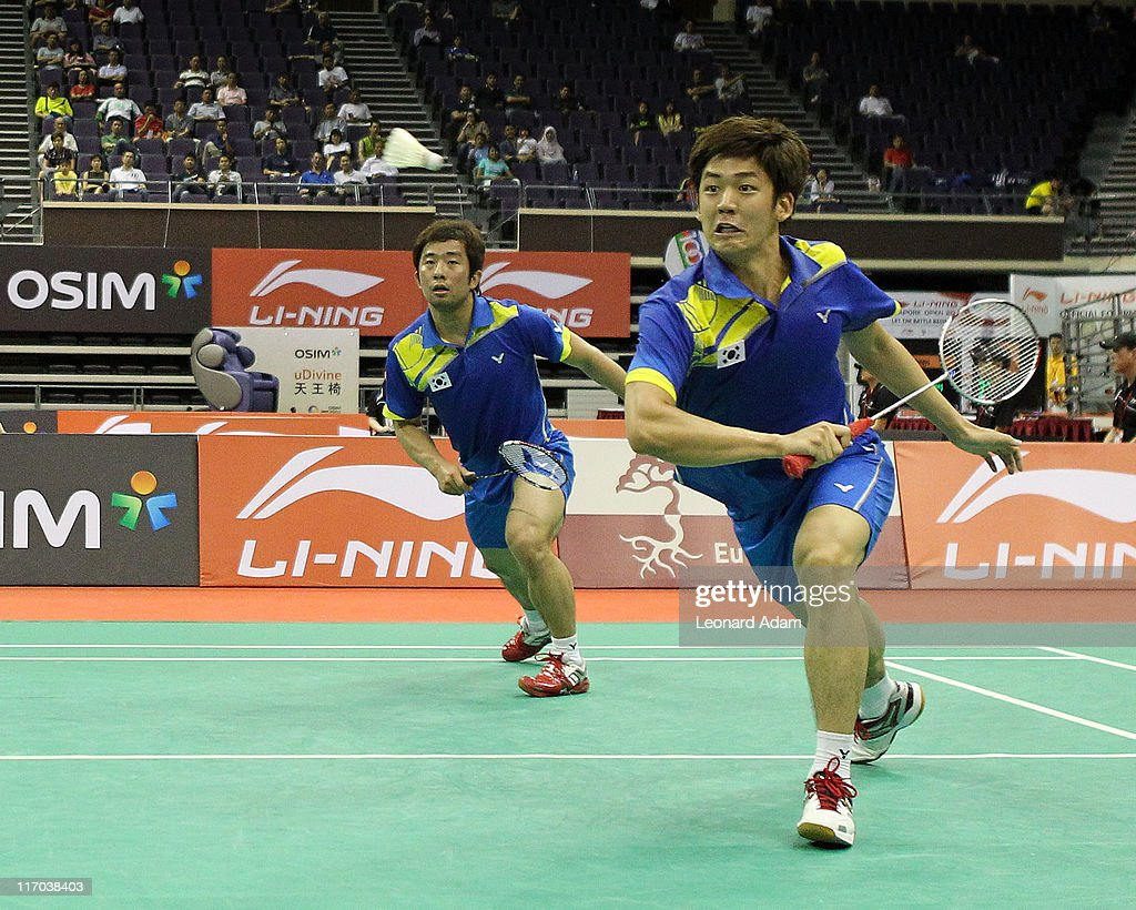 Jae Sung Jung and Yong Dae Lee of Korea compete in their match against Hiroyuki ENDO and Kenichi HAYAKAWA of Japan during day four of the Li-Ning Singapore Open at Singapore Indoor Stadium on June 17, 2011 in Singapore.