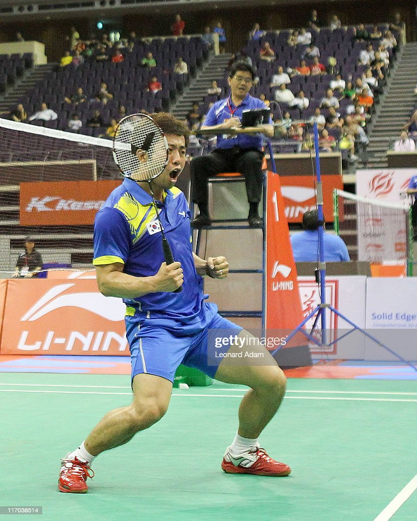 Jae Sung Jung and Yong Dae Lee of Korea competes in their match against Kenichi HAYAKAWA and Hiroyuki ENDO of Japan during day four of the Li-Ning Singapore Open at Singapore Indoor Stadium on June 17, 2011 in Singapore.
