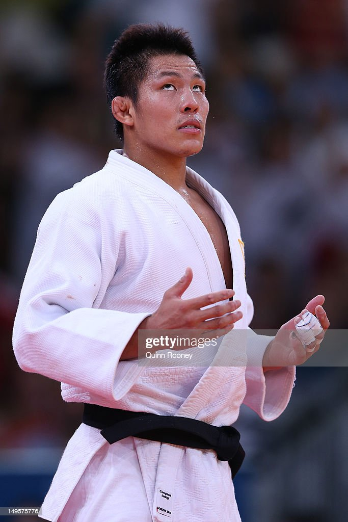 <a gi-track='captionPersonalityLinkClicked' href=/galleries/search?phrase=Jae-Bum+Kim&family=editorial&specificpeople=4920078 ng-click='$event.stopPropagation()'>Jae-Bum Kim</a> of Korea (white) reacts after his match with Ivan Nifontov of Russia in the Men's -81 kg Judo on Day 4 of the London 2012 Olympic Games at ExCeL on July 31, 2012 in London, England.