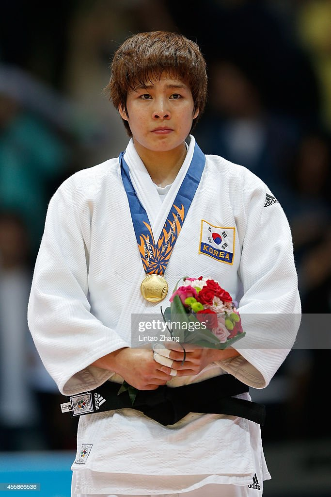 Jaebum Kim of South Korea celebrates during the medal ceremony after the Women's -70 kg Final against Chizuru Arai of Japan at Dowon Gymnasium during day two of 2014 Asian Games on September 21, 2014 in Incheon, South Korea.