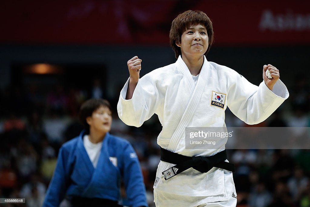 Jaebum Kim of South Korea celebrates winning gold in the Women's -70 kg Final against Chizuru Arai of Japan at Dowon Gymnasium during day two of 2014 Asian Games on September 21, 2014 in Incheon, South Korea.