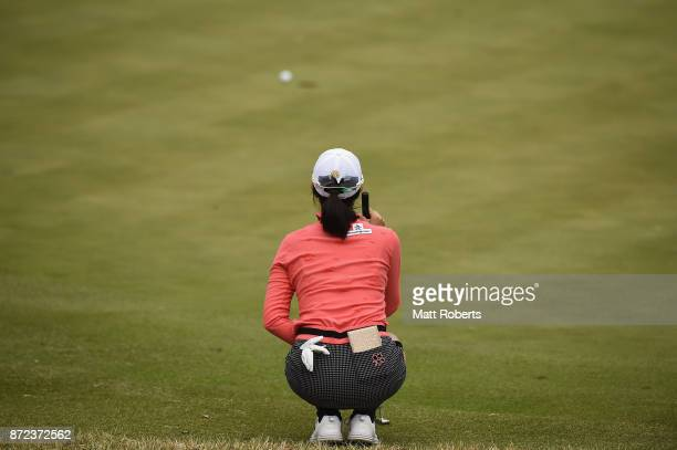 JaeEun Chung of South Korea waits to putt on the 3rd green during the first round of the Itoen Ladies Golf Tournament 2017 at the Great Island Club...