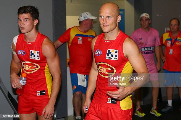 Jaeger O'Meara and Gary Ablett of the Suns celebrate winning the round three AFL match between the Gold Coast Suns and the Brisbane Lions at Metricon...