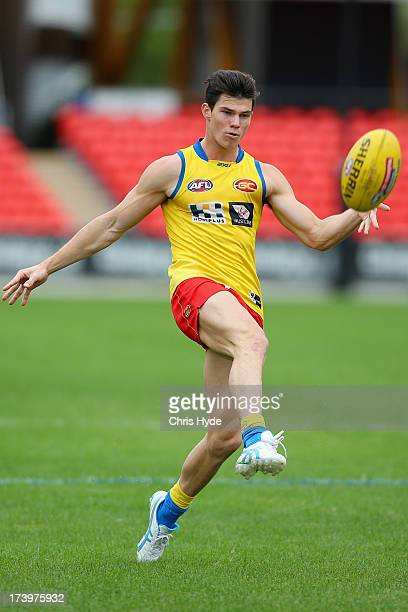 Jaeger O'Meara kicks during a Gold Coast Suns AFL training session at Metricon Stadium on July 19 2013 in Gold Coast Australia