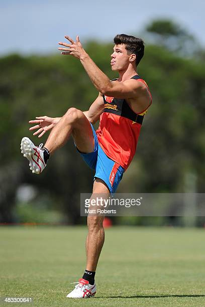 Jaeger O'Meara kicks the ball during a Gold Coast Suns AFL training session at Metricon Stadium on April 8 2014 on the Gold Coast Australia