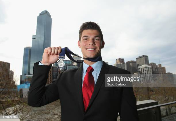 Jaeger O'Meara of the Gold Coast Suns poses after winning the 2013 Ron Evans Medal NAB Rising Star Award as the best young player in the AFL at Crown...