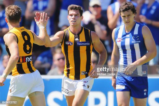 Jaeger O'Meara of the Hawks celebrates a goal during the JLT Community Series AFL match between the North Melbourne Kangaroos and the Hawthorn Hawks...