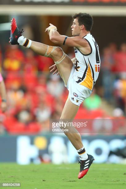 Jaeger O'Meara of the Hawks kicks a goal during the round three AFL match between the Gold Coast Suns and the Hawthorn Hawks at Metricon Stadium on...