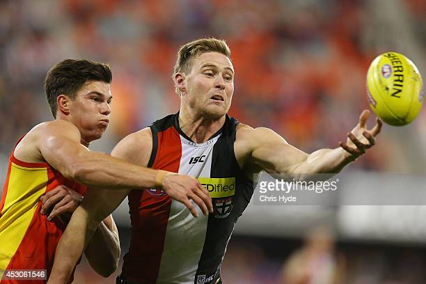 Jaeger O'Meara of the Suns and David Armitage of the Saints compete for the ball during the round 19 AFL match between the Gold Coast Suns and the St...