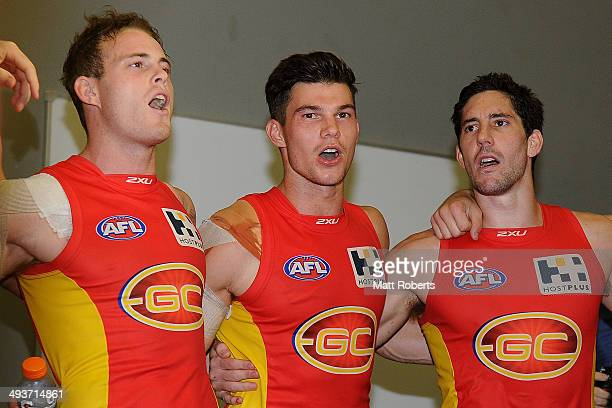 Jaeger O'Meara of the Suns celebrate victory with teammates after the round 10 AFL match between the Gold Coast Suns and the Western Bulldogs at...