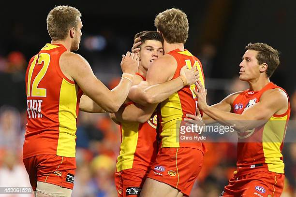 Jaeger O'Meara of the Suns celebrates a goal during the round 19 AFL match between the Gold Coast Suns and the St Kilda Saints at Metricon Stadium on...