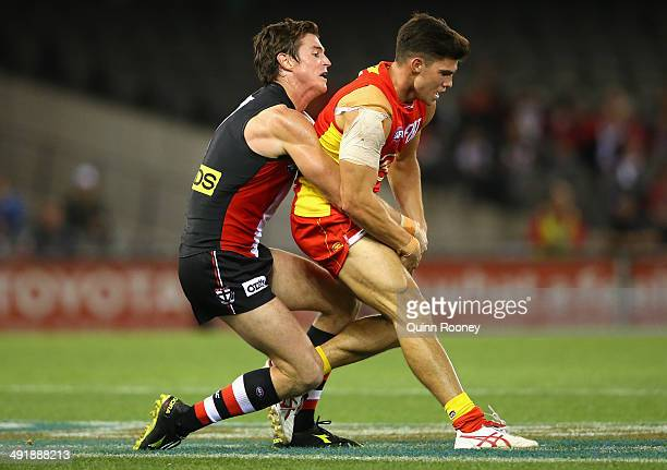 Jaeger O'Meara of the Suns is tackled by Lenny Hayes of the Saints during the round nine AFL match between the St Kilda Saints and the Gold Coast at...
