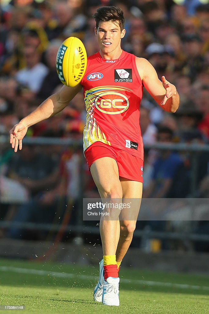 Jaeger O'Meara of the Suns kicks during the round 16 AFL match between the Richmond Tigers and the Gold Coast Suns at Cazaly's Stadium on July 13, 2013 in Cairns, Australia.